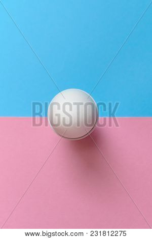 White Egg Standing On Egg Cup On Blue And Pink Pastel Background, Copy Space. Boiled Egg In Stand On