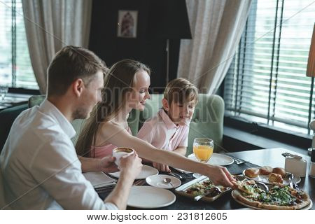 Dining family with child at restaurant
