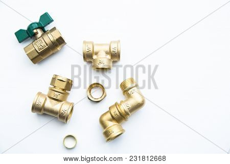 Various Plumbers Tools And Plumbing Materials Including Coper Pipe, Elbow Joint, Wrench And Spanner.