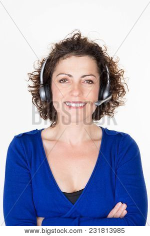 Attractive Young Dark Hair Caucasian Callcenter Operator Is Talking On The Headset