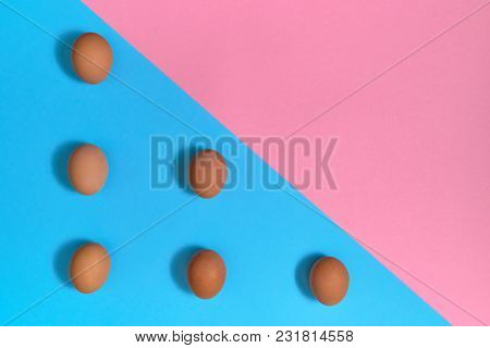 Brown Eggs On Blue And Pink Pastel Background, Copy Space. Eggs On Paper Background With Two Tone Co
