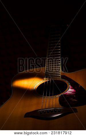 Acoustic Guitar On Black Background. N Studio