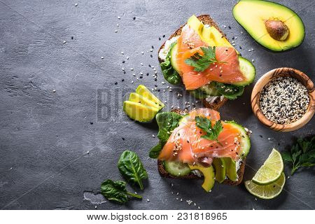 Open Sandwich Or Toast. Grain Bread With Salmon, White Cheese, Avocado, Cucumber And Spinach. Health