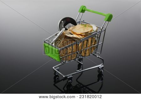 Basket From Supermarket With Coins Crypto Currency E Bitcoin Etherium Litetcoin On A Black Gray Back