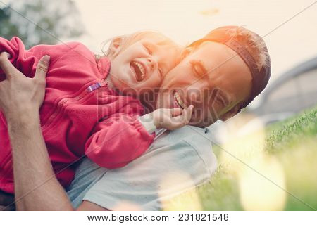 Young Father And Daughter Spending Time In The Park, Happy Family, Intentional Sun Glare And Lens Fl