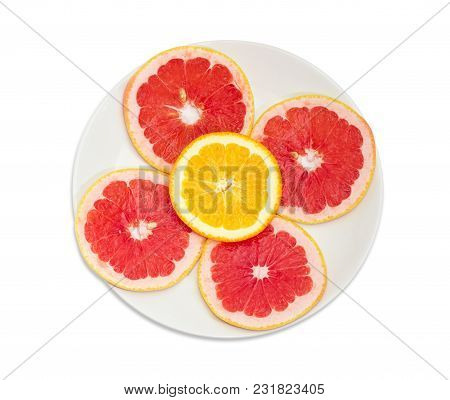Top View Of The White Dish With Several Round Slices Of The Ripe Red Grapefruit And One Slice Of Ora