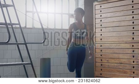 Young Fit And Tone Up Woman Doing Heating Before A Fitness Workout In Sunny Loft Running In Place An