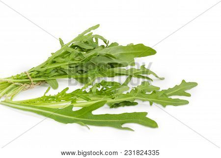 Several Leaves And Bundle Of The Fresh Arugula Tied With Twine Closeup On A White Background