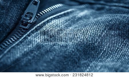 Denim Clothes Lying On The Table With The Glasses. Blue Jeans