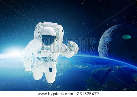 astronaut flies over the earth in space. Elements of this image furnished by NASA