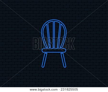 Neon Light. Chair Sign Icon. Modern Furniture Symbol. Glowing Graphic Design. Brick Wall. Vector