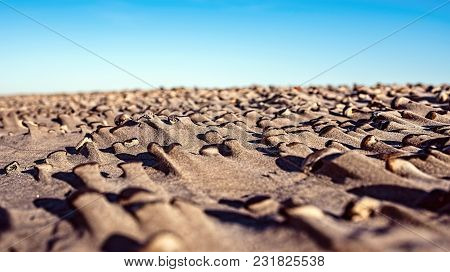 Natural Sculptures Of Sand And Stones On The Beach After Storm