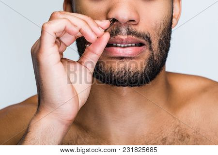 Pampering Is Important For Every Man. Part Of Handsome Shirtless Young Black Man Removing Hair From