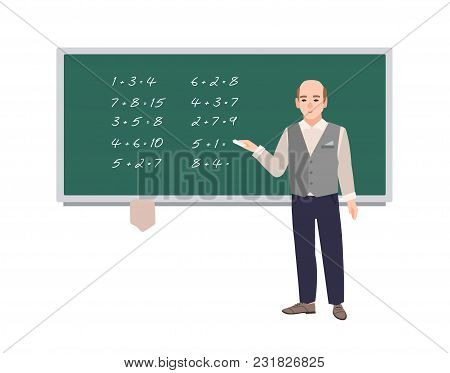 Male School Math Teacher Writing Mathematical Expressions On Green Chalkboard. Smiling Man Teaching