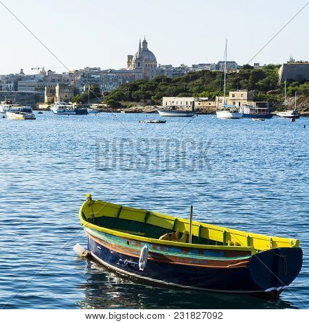 Cityscape View With Basilica Of Our Lady Of Mount Carmel On The Island Of Malta. Yachts Docked At Th