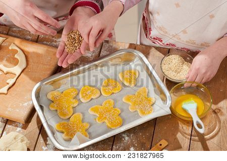 raw cookies in baking tray, sweet food concept