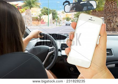 Someones Driving Car And Hand Phone With Empty Screen For Copy Space