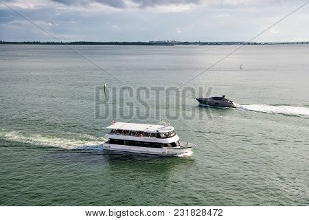 Miami, Usa - November 22, 2015: Ship And Boat Float In Sea On Blue Sky. Water Transport, Vessels. Su