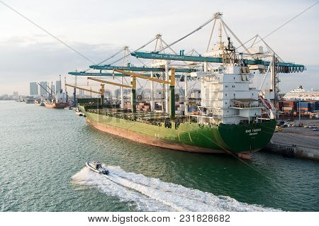 Miami, Usa - March, 18, 2016: Cargo Ship With Cranes In Sea Port. Maritime Container Port Or Termina