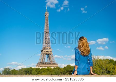 Woman In Blue Dress Look At Eiffel Tower In Paris, France, Fashion. Woman With Long Hair, Hairstyle,