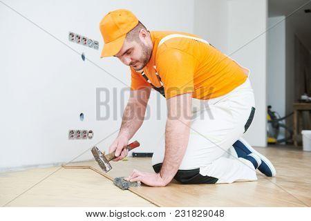 worker joining parquet floor.