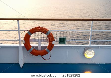 Buoy Or Lifebuoy Ring On Shipboard In Evening Sea In Miami, Usa. Flotation Device On Ship Side On Se