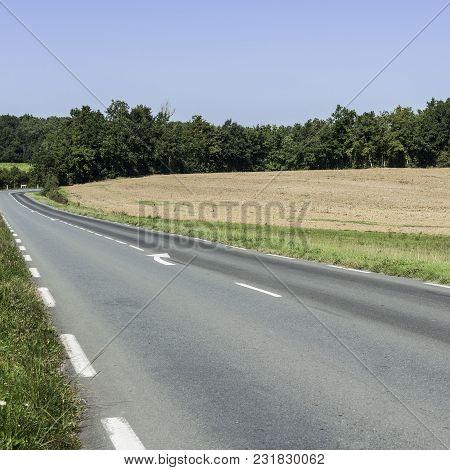 Asphalt Road Between Autumn Plowed Fields In France After Harvest