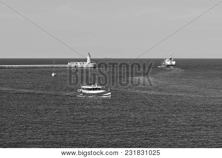 Cargo Ship Leaves The Harbor Of Valletta. Lighthouses Indicate The Entrance To The Ports Of Malta. P