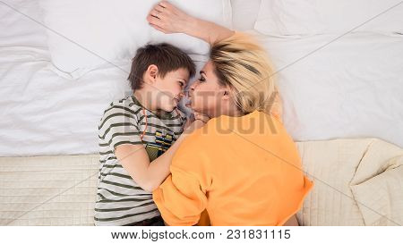 Mother With Son On Bed, Mother Kissing Her Son, Mother And Son Having Fun, Mom And Her Teenager Son