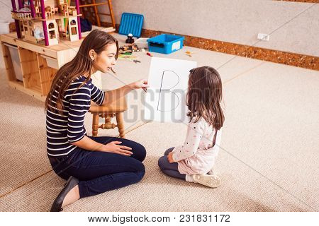 Beautiful Young Teacher Showing Letter The Girl