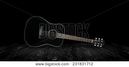 Musical Instrument - Black Acoustic Guitar On Black Background.
