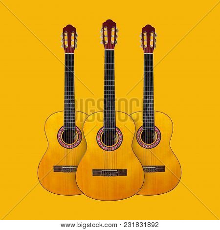 Musical Instrument - Three Classic Guitar On A Yellow Background.