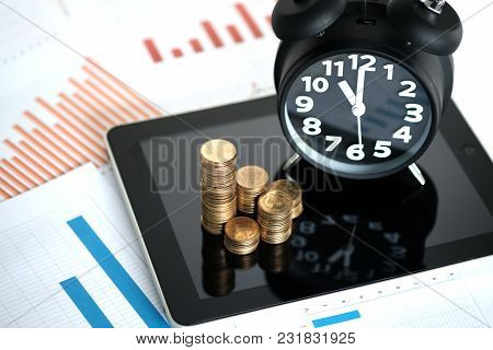 Step Of Coins Stacks And Alarm Clock With Tablet Computer And Financial Graph, Business Planning Vis