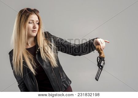 Girl In Red Has Found A Black Revolver.