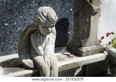 Detail Of A Tomb With A Sad Angel At The Lafayette Cemetery No. 1 In The City Of New Orleans, Louisi