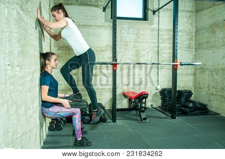 Two Young Fitness Girls Workout Strength And Conditioning Training In The Gym