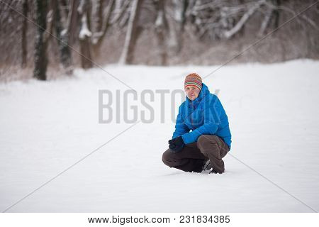 Winter Portrait Of Man At The Cold Weather Outdoor. Portrait Of Happy Man Smiling Outdoors During Co