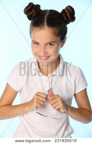 Portrait Of A Charming Pretty Stylish Young Teenage Schoolgirl. Beautiful Brunette Child Is Smiling