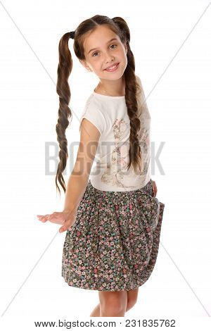 Portrait Of A Little Girl 12 Years Old In Summer Clothes. Charming Pretty Young Teenager Is In A Ski
