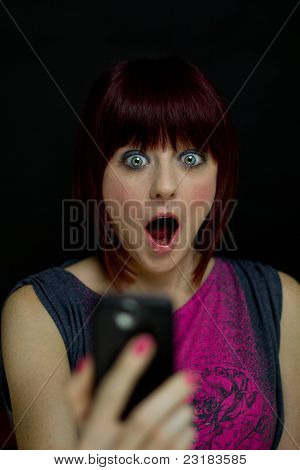 Girl Shocked At Text Message On Cell Phone