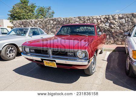 Beit Nir, Israel - March 17, 2018: Ratty Muscle Car Dodge Dart Swinger Presented On Oldtimer Car Sho