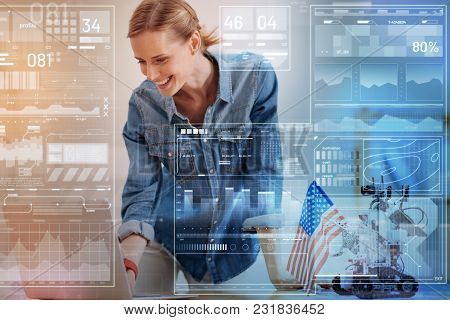 Unique Invention. Cheerful Enthusiastic Young Engineer Looking At The Screen Of Her Convenient Moder