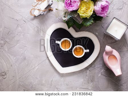 Two White Cups Of Espresso On The Chalkboard Heart Tray