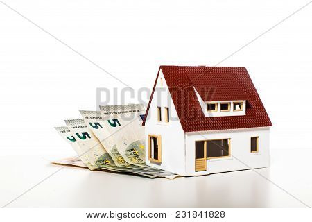 Money House From The Coins On The White Background. Concept For Utility Payments, Subsidy