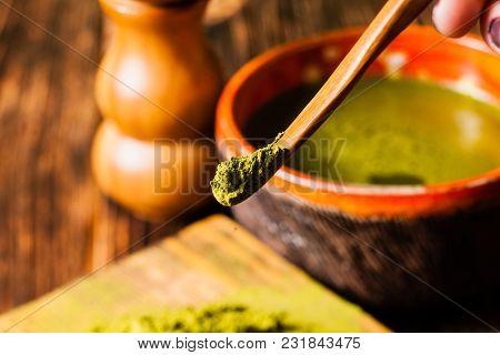 Matcha Tea Powder Close Up On A Wooden Scoop