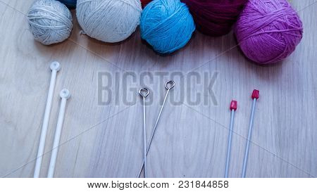 Balls Of Woolen Yarn For Knitting On The Table.