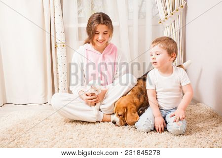 Brother And Sister With Their Pets In The Room