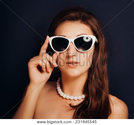 Woman On A Dark Background Close-up With Glasses. Pin-up Style