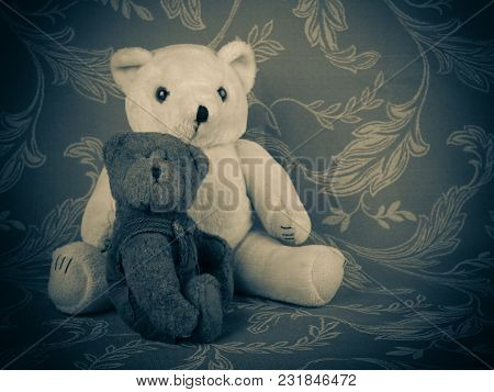 Two Cute Teddy Bears On The Grey Background With Pattern. Relationship,  Familyship And  Child Care