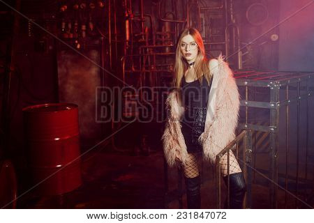 Young Attractive Woman With Stylish Clothes. Beautiful Girl In A Fluffy Pink Fur Coat, Cyberpunk Bac